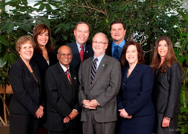 Image of the eight members of the Board of Trustees, standing