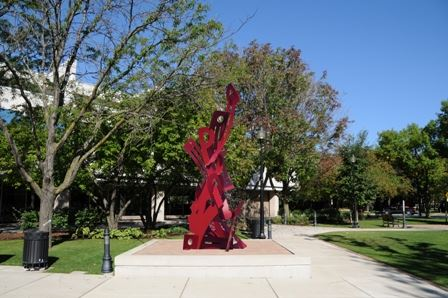 Image of a red abstract metal sculpture in a park
