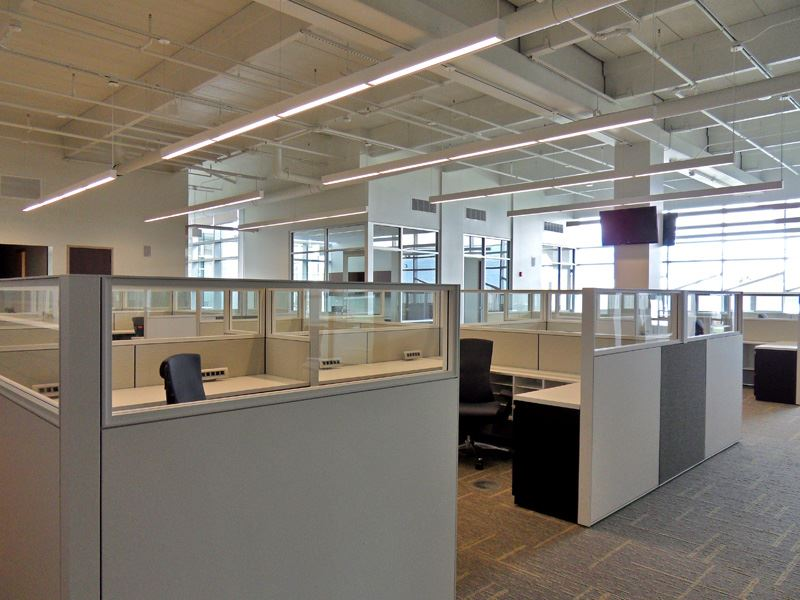 Image of many bare cubicles and chairs