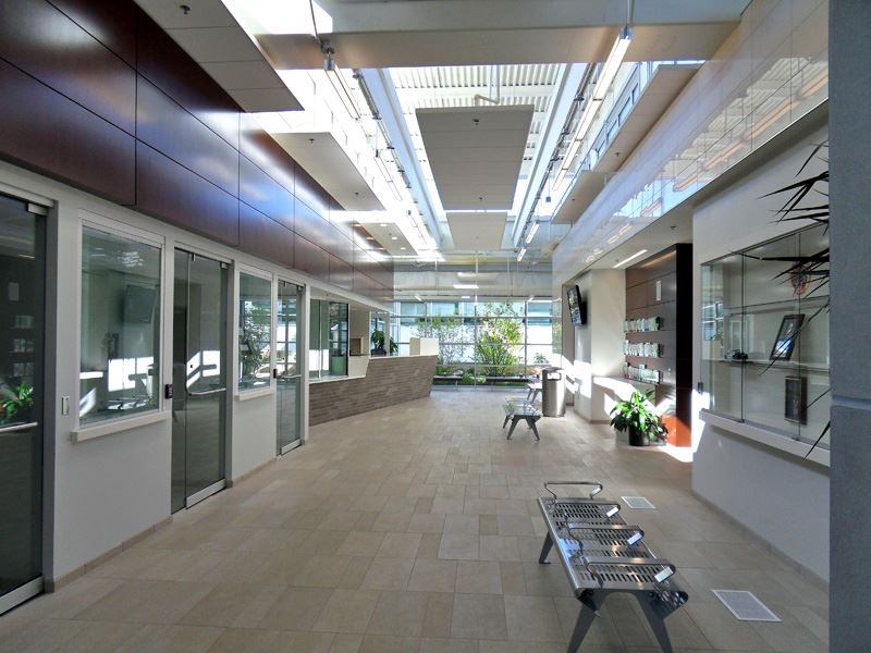 Image of hallway with benches, glass display cases, and a front desk