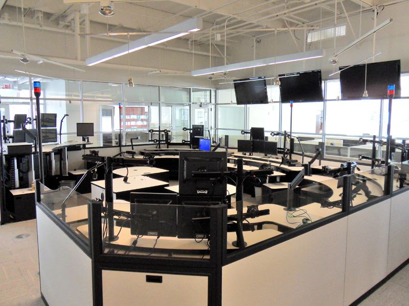 Alternate image of circular area with computers and televisions